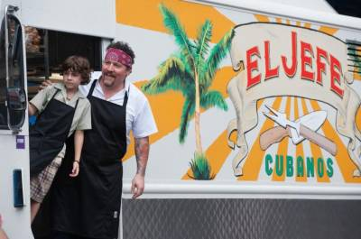 Chef Leaning Out of Food Truck